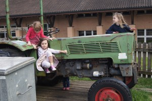 Lilly, Pia and Sophie playing on a tractor