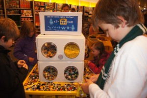 Matthew making his mini figures in the lego store